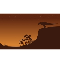 Silhouette of tyrannosaurus on cliff vector