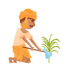 Man in indian clothing weeds a garden vector