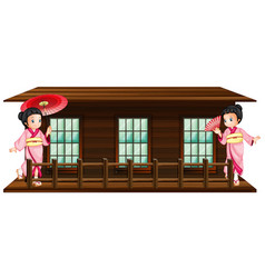 two japanese girls at wooden hut vector image vector image