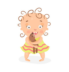 Cute cartoon curly baby girl in yellow dress vector