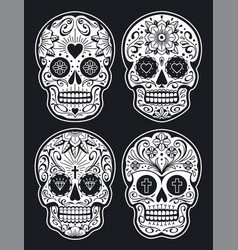 Mexican skulls with patterns vector
