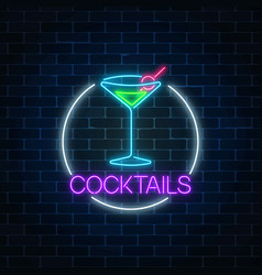 Neon cocktail sign in circle frame on dark brick vector