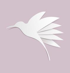 Cut paper hummingbird on violet background vector