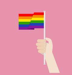 hand holding up lgbtq rainbow flag vector image