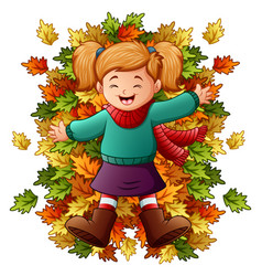 Happy little girl playing with autumn leaves vector