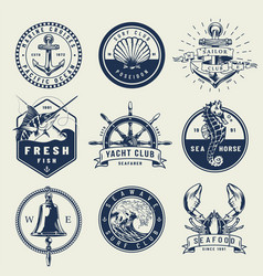 Vintage monochrome nautical emblems vector