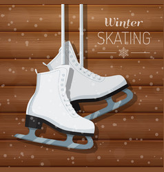 White ice skates on wooden vector