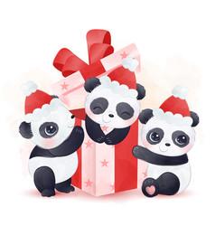 Pandas playing with gift box and wearing santa hat vector