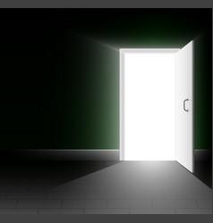an open door in a dark room a ray of light shines vector image