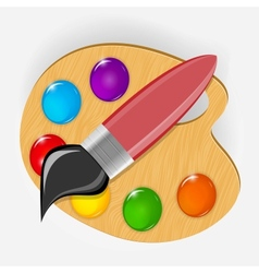 Wooden art palette with paints and brushe icon vector image