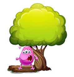 An angry beanie monster under the big tree vector image