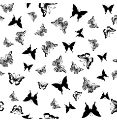 Seamless pattern with silhouettes of butterflies vector