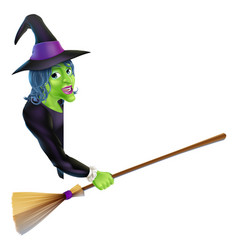 Halloween witch pointing with broom vector