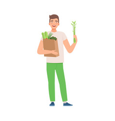 Man holds a bag vegetables vector