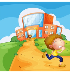 A boy running and a lion near the school vector image vector image
