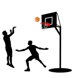 Black silhouettes of men playing basketball on a vector image