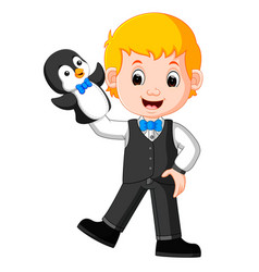 boy was using penguin puppet with blue bow tie vector image