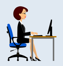 businesswomen sitting at the computer in the vector image