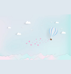 balloon flying over cloud with pink heart float vector image