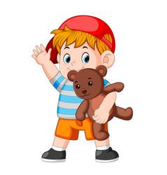 a boy funny play with the teddy bear vector image