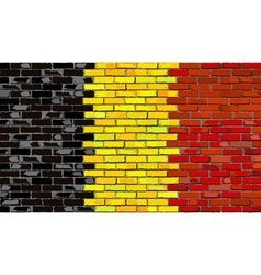Grunge flag of Belgium on a brick wall vector image vector image