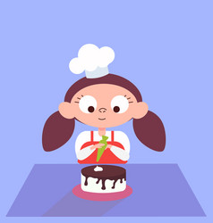 Girl decorating chocolate cake in the kitchen vector