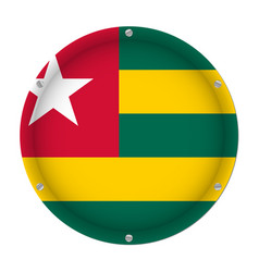 Round metallic flag of togo with screws vector