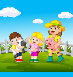 Young women holding pig and happy kids vector