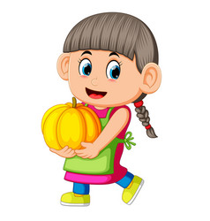 happy girl holding pumpkin vector image