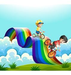 Kids riding bike over the rainbow vector