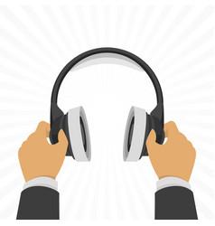 headphones in hands vector image