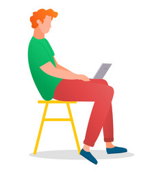 man sitting on tabouret and working with vector image