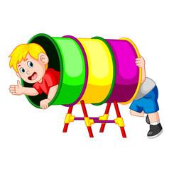 boys happy play in the rainbow tube vector image