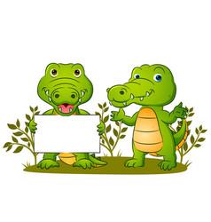 Couple cute crocodile is holding vector