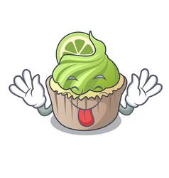 Tongue out lemon cupcake mascot cartoon vector
