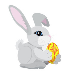 the gray rabbit holding a yellow and red colored vector image