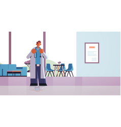 male doctor standing in contemporary clinic hall vector image