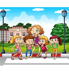 Kids and teacher at school ground vector image vector image