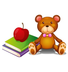 An apple above the books and a huggable bear vector image