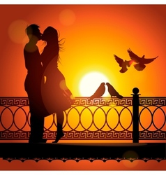 Silhouette of couple in love kissing at sunset vector image