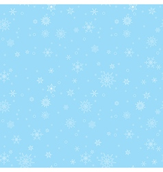 Blue seamless pattern with white snowflakes vector