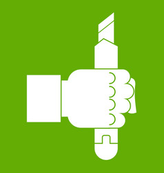 hand hoding construction utility knife icon green vector image