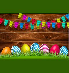 Decorated easter egg green grass wooden vector