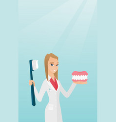 dentist with a dental jaw model and a toothbrush vector image