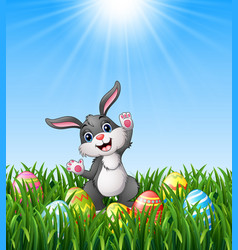 cartoon rabbit with easter eggs in the grass vector image