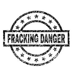 Grunge textured fracking danger stamp seal vector