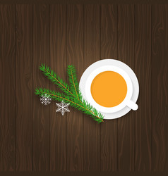 christmas tree branches with snowflakes and a cup vector image