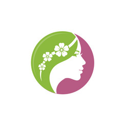 Beautiful woman with flower logo vector