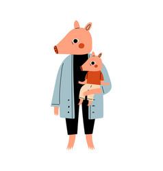 mother pig holding piglet on her hands loving vector image