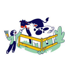 Cheerful kid feeding cute cows in wooden cage vector